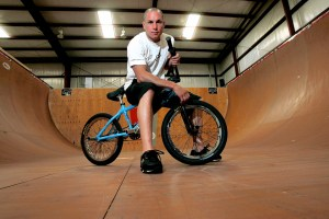 FILE - In a Friday, June 24, 2005 file photo, X-Games athlete Dave Mirra poses in the half-pipe at his training facility in Greenville, N.C. Police say veteran X Games biker Dave Mirra has died in North Carolina. Greenville police said Thursday, Feb. 4, 2016, that Mirra's body was found earlier in the day with an apparently self-inflicted gunshot wound.He was 41.  (AP Photo/Gerry Broome, File)