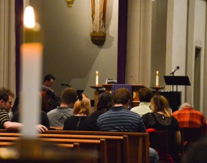 Joseph Guzy | Photo Editor A candle burns at Wednesday's memorial mass for deceased graduate student Cheyenne Warner.