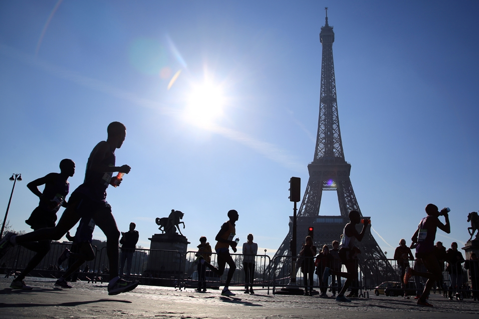 Runners participate in the 40th Paris Marathon with the Eiffel Tower in the background. & Second language door to new experiences friends \u2022 The Duquesne Duke