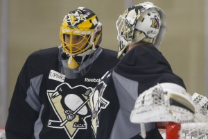 Pittsburgh Penguins goalie Marc-Andre Fleury, left, talks with goalie Jeff Zatkoff during a practice session for the NHL hockey playoffs against the New York Rangers, Monday, April 11, 2016, at their practice facility in Cranberry, Pa. (AP Photo/Keith Srakocic)