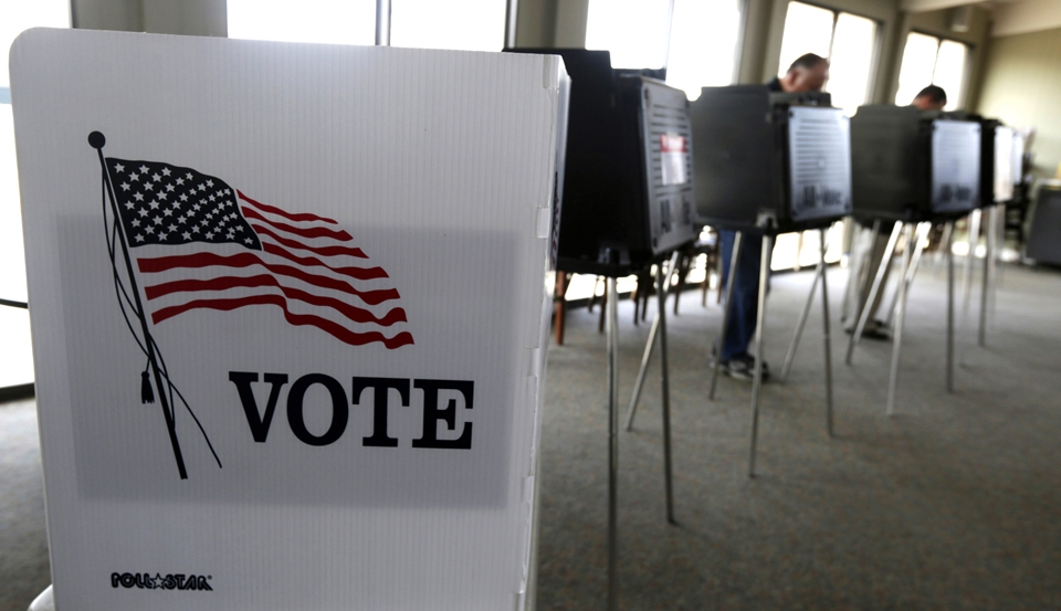 AP Photo   In this Mar. 18, 2014 file photo, voters cast their ballots in the Illinois primary in Hinsdale, Ill. Duquesne students not yet registered to vote can still do so by Oct. 11.