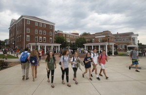 "FILE - In this Sept. 7, 2016, file photo, Longwood University students walk to class at the school in Farmville, Va. The school is hosting the vice presidential debate on Oct. 4. Tuesday night's vice presidential debate between Republican Gov. Mike Pence of Indiana and Democratic Sen. Tim Kaine of Virginia pits a former radio host who's described himself as ""Rush Limbaugh on decaf"" against a harmonica-playing former missionary whose aw-shucks style has spawned a thousand dad jokes. (AP Photo/Steve Helber, File)"