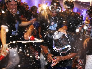 AP Photo/Nam Y. Huh Chicago Cubs players celebrate the team's having won the NL Central title, after the Cubs defeated the Milwaukee Brewers 5-4 in 10 innings in a baseball game Friday, Sept. 16, 2016, in Chicago. The Cubs won the title when the St. Louis Cardinals lost to the San Francisco Giants on Thursday night.