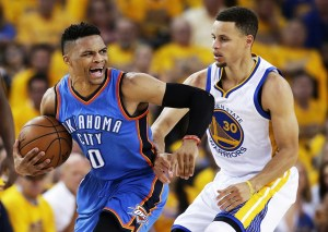 FILE - In this Wednesday, May 18, 2016 file photo, Oklahoma City Thunder guard Russell Westbrook (0) reacts as he is guarded by Golden State Warriors guard Stephen Curry (30) during the second half of Game 2 of the NBA basketball Western Conference finals in Oakland, Calif.,  There were few indications before August that Russell Westbrook would be so willing and able to be the hero downtrodden Thunder fans needed. Now that he has answered the call, it's time to deliver. (AP Photo/Marcio Jose Sanchez, File)