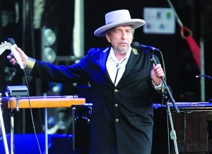 "AP Photo FILE - This July 22, 2012, file photo shows U.S. singer-songwriter Bob Dylan performing onstage at ""Les Vieilles Charrues"" Festival in Carhaix, western France. Dylan won the 2016 Nobel Prize in literature, announced Thursday, Oct. 13, 2016. (AP Photo/David Vincent, File)"