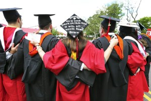 AP Photo In this May 15, 2016 file photo, students embrace as they arrive for the Rutgers graduation ceremonies in Piscataway, N.J. Those graduating might find themselves stuggling with private student loans.