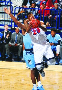 Courtesy of Duquesne Athletics  Sophomore forward Nakye Sanders drives to the basket in a blowout loss to the URI Rams on Jan. 21 at the A.J. Palumbo Center.