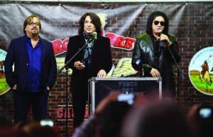 """Paul Stanley, center, and Gene Simmons of KISS speak during a during a press conference for the ground breaking of their """"Rock and Brews Casino Resort"""" in Braman, Okla., Jan. 12, 2017. (Jessie Wardarski/Tulsa World via AP)"""