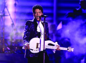 "AP Photo Bruno Mars payed tribute to Prince, playing ""The Bird"" and ""Jungle Love"" from 1984's Purple Rain."