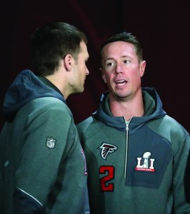 Atlanta Falcons' Matt Ryan talks to New England Patriots' Tom Brady during opening night for the NFL Super Bowl 51 football game at Minute Maid Park Monday, Jan. 30, 2017, in Houston. (AP Photo/Charlie Riedel)