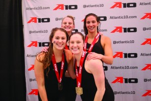 Courtesy of the Atlantic 10 Conference | The Duquesne 400-yard freestyle relay team of Lauren Devorace (front left), Carson Gross (back left), Molly O'Brien (front right) and Lexi Santer (back right) pose after their medal-winning swim at A-10s.