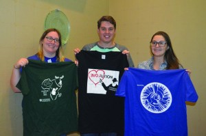 Taylor Carr|Staff Photographer Neil Lax and members of the Duquesne Biology Club sell t-shirts at the Bayer School's annual Darwin Day. British professor, Nick Lane, was the featured speaker.