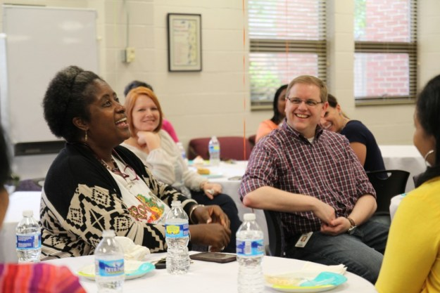 Johnnie Bratton, an Associate Degree in Nursing instructor, shares a laugh with the New Faculty Mentor Program group in the Teaching-Learning Center on May 12, 2016.