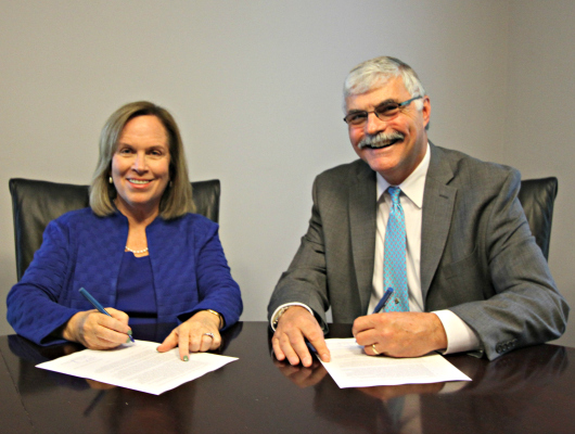 Jane Fernandes, president of Guilford College, and Dr. Bill Ingram, president of Durham Tech sign articulation agreement
