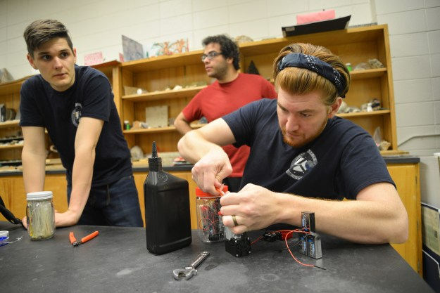 Durham Tech alumnus Jimmy Acevedo, a project leader for a Durham Tech group involved in the High Altitude Student Platform flight program, connects a pump for a test exercise. The NASA-involved project will involve a dozen colleges and universities from across the country.