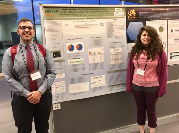 Michael Herrera and Roselyn Barahona present the Phage Hunters class poster entitled Phage Pharming: Characterization of Two Novel Phages, Kimchi and Glexan, Isolated in the Gardens of North Carolina.