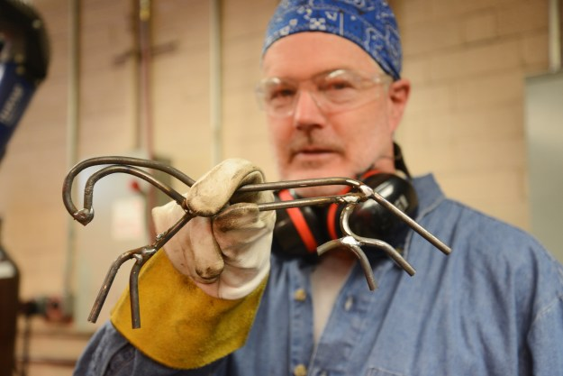 Terry Ford puts final touches on the horse he made.