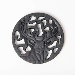 CAST IRON TRIVET BUCK