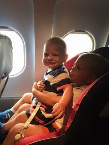 Boys in the Car Seat on the Plane