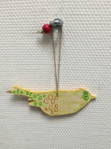 """This adorable handmade bird is the """"Do Not Disturb"""" at the Townhouse Hotel."""