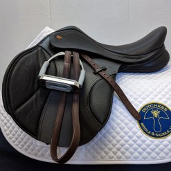 Kent & Masters Compact GP saddle with girth, stirrups, and leathers