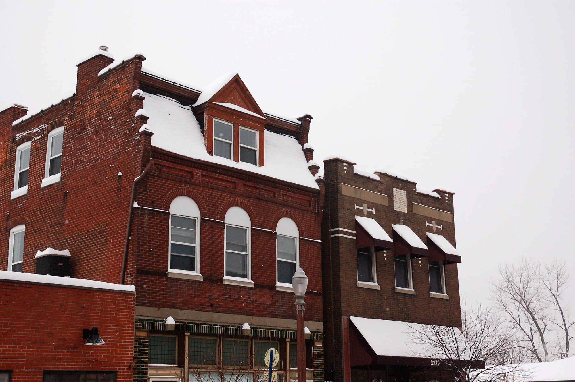Buildings on Meramec Street in the snow.