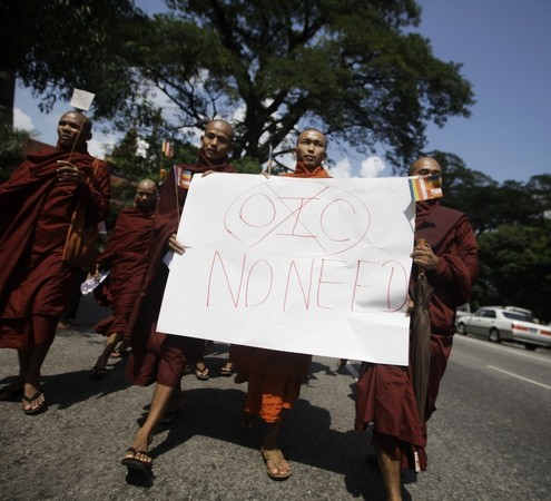 Buddhist monks hold a placard as they protest against the opening of Organization of Islamic Cooperation offices in Myanmar