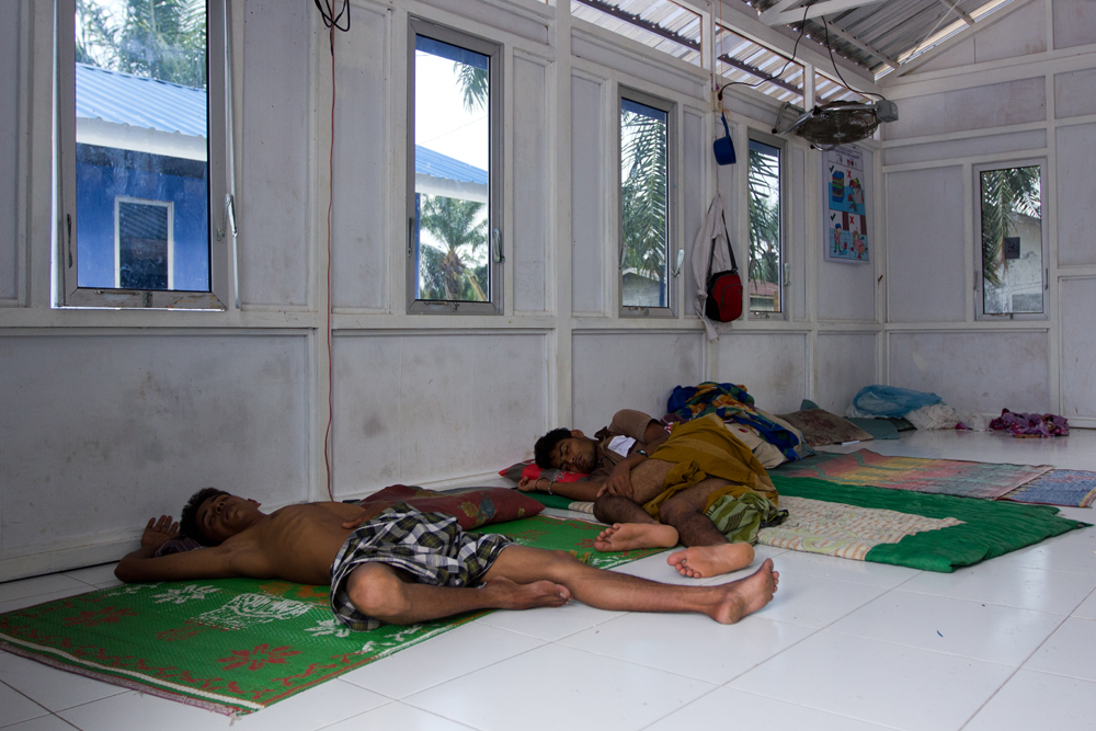 Two Rohingya men take a nap in their room at Bayeun Refugee Camp, in the outskirts of Langsa City (Aceh Province, Indonesia). Photo: Carlos Sardiña Galache / Yayasan Geutanyoe – A Foundation for Aceh.