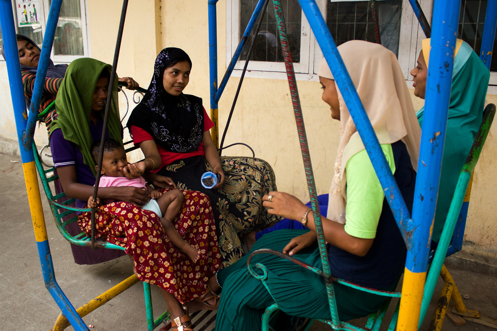 A group of Rohingya women relax in Lhok Bani Refugee Camp, in Langsa City (Aceh Province, Indonesia). Photo: Carlos Sardiña Galache / Yayasan Geutanyoe – A Foundation for Aceh.