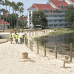Construction workers building the fence at Disney's Grand Floridian