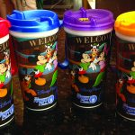 A red, blue, purple and orange mug for a special meet and greet at Walt Disney World
