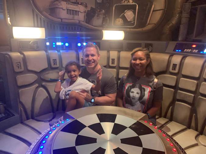 Family sitting at the game table in the Millenium Falcon