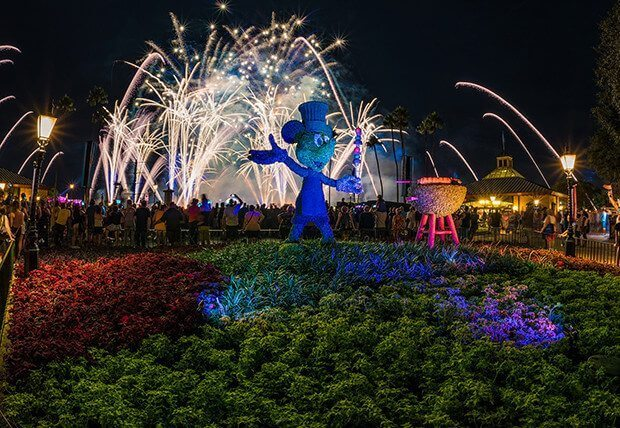 Epcot's Food and Wine Festival Fireworks behind a blue topiary Mickey Mouse