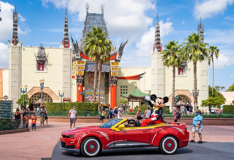 Mickey pictured waving from a Cars convertible at Disney's Hollywood Studios