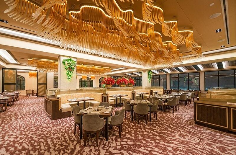 Tables inside Topolino's Terrace at the Riviera Resort
