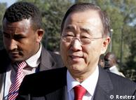 Close-up of Ban in suit with red tie arriving at AU summit