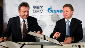 two men signing document