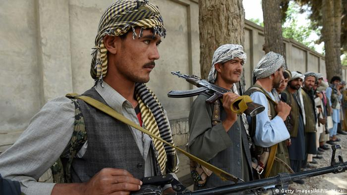 Afghan militia forces as they stand with their weapons in Kunduz<br /><br /> (Photo: SHAH MARAI/AFP/Getty Images)