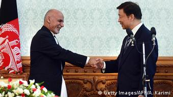 Afghan president Asharaf Ghani (L) shakes hands with China's Vice President, Li Yuanchao at a joint press conference at the Presidential Palace in Kabul on November 3, 2015. (Photo: Aref Karimi/AFP/Getty Images)