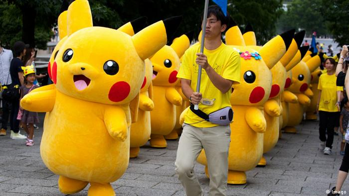 A group of Pikachus march in a street parade in Japan. (Photo: