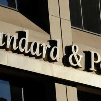 China fumes over S&P credit rating downgrade