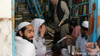 seminary students purchase books from an Islamic book shop in Peshawar