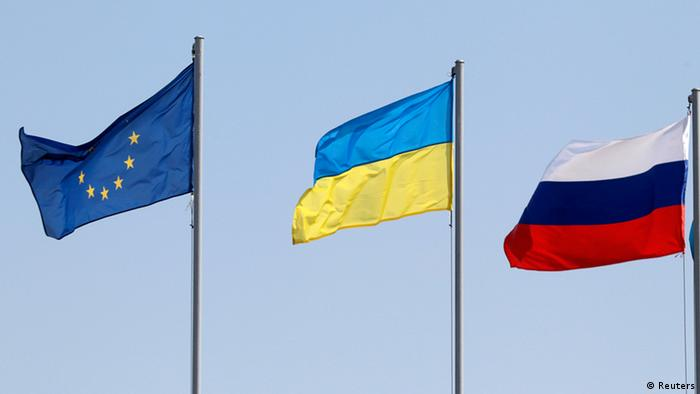EU, Ukrainian and Russian flags (Reuters)