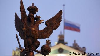 Russian flag behind eagle statue