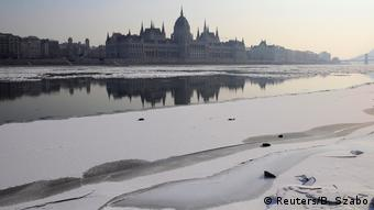 Hungarian parliament bulilding is seen as ice floes float on the Danube river in Budapest