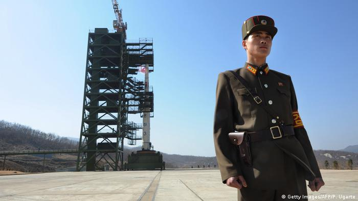 April 8, 2012 A North Korean soldier stands guard in front of an Unha-3 rocket at the Sohae Satellite Launch Station in Tongchang-Ri on April 8, 2012. North Korea has confirmed their intention to launch the rocket next week despite international condemnations. (Getty Images/AFP/P. Ugarte)