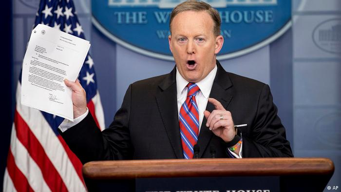 White House press secretary Sean Spicer holds up a document concerning the Washington Post story on Sally Yates, March 28.