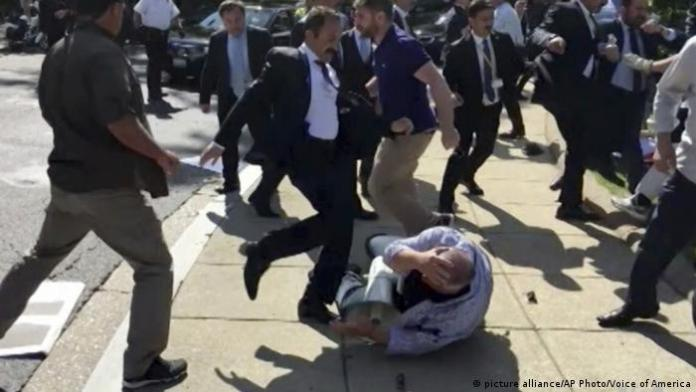 Members of Erdogan's security detail violently reacting to peaceful protesters during Erdogan's trip last month to Washington.
