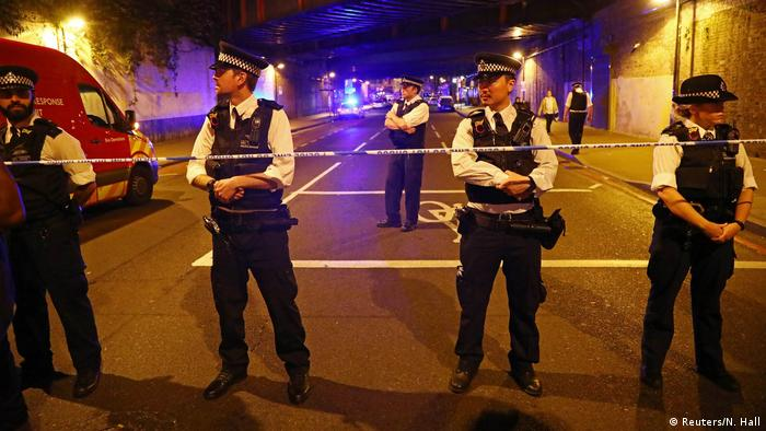 Police stand at the scene of what they described as a 'major incident' in Finsbury Park
