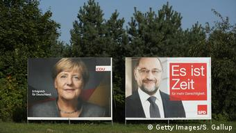 Campaign posters for Merkel and Schulz